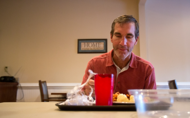 Jim eats lunch in the dining room of the memory care unit during his first afternoon at Commonwealth Assisted Living in Hampton. (Karen Garner)