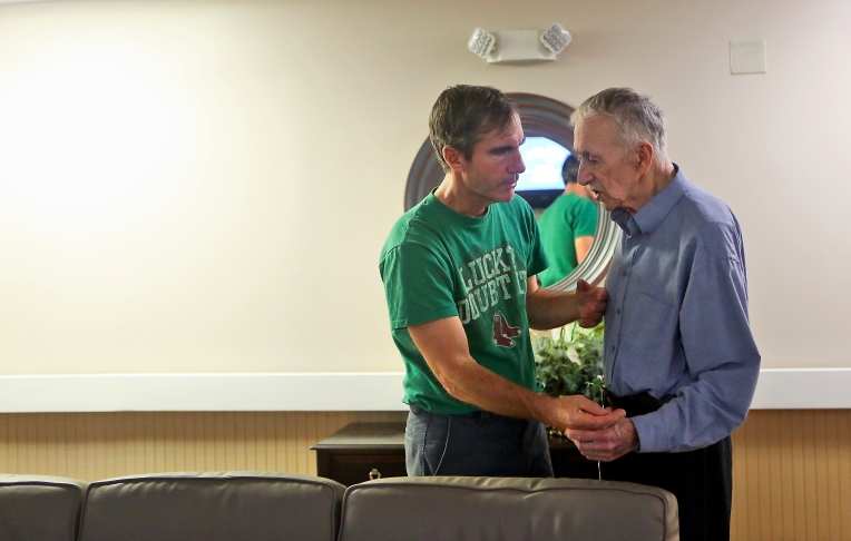 Jim talks with another resident while walking the hallways of the secure memory unit at Commonwealth Assisted Living in early October. (Kaitlin McKeown)