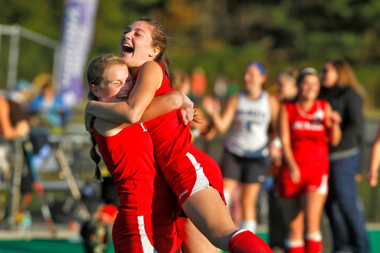 Gloucester's Karly Harwood, left, celebrates with Shaelyn McNeil after defeating Deep Run during Saturday's 5A state championship game at the National Field Hockey Training Center in Virginia Beach on November 14, 2015.