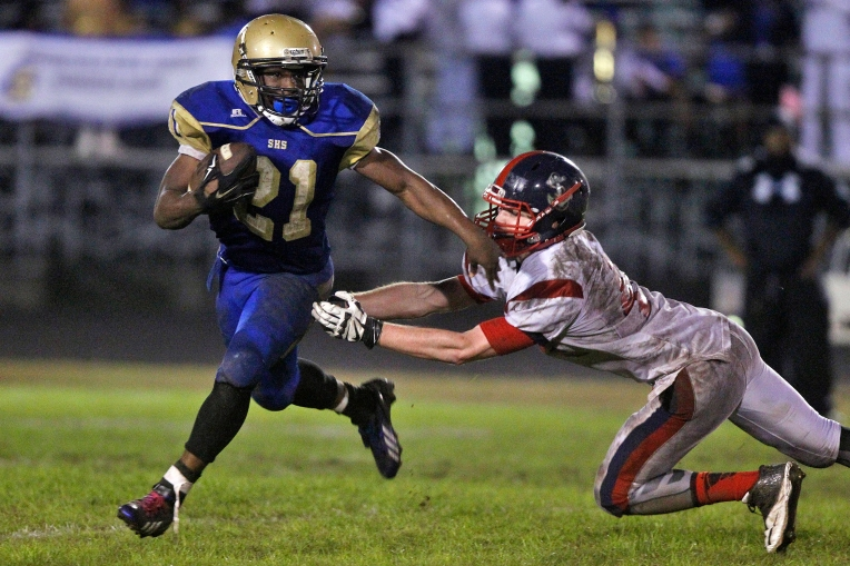 Grafton's David Kornegay, right, chases after Smithfield's William Robinson during Friday's game November 6, 2015.