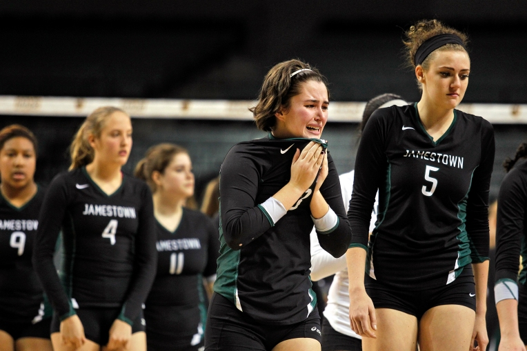 Jamestown's Maggie Viniard, center, walks off the court in disappointment after losing to Loudoun County during Saturday's 4A state championship volleyball game at VCU's Siegel Center on November 21, 2015.