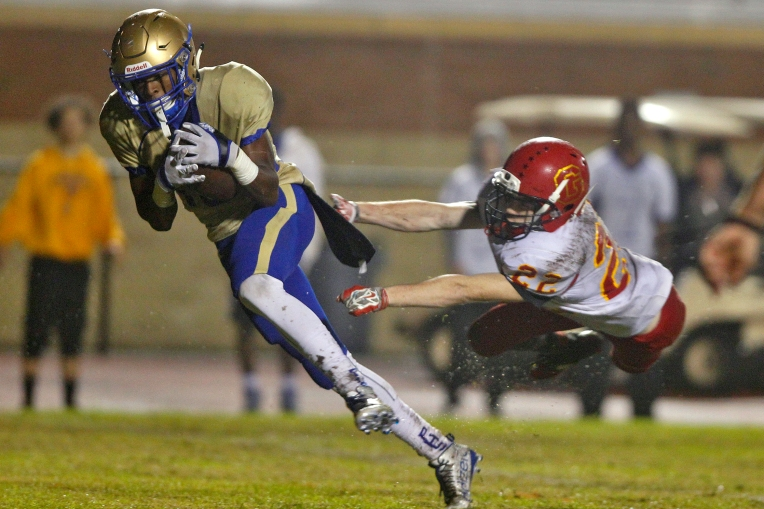 Phoebus' Andre Jackson avoids the tackle of Gloucester's Maison Hayes for a touchdown during Thursday's game at Darling Stadium November 5, 2015.