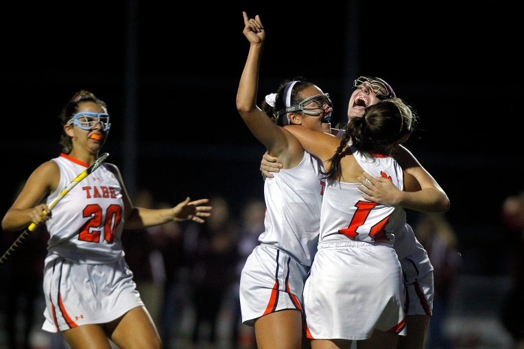 From left, Tabb's Abby Heckler, Miya Denison, Courtney Fiest and Jessie Meyers celebrate after the first goal during Wednesday's game against Poquoson November 4, 2015.