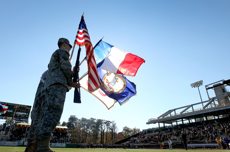 The French flag is carried by the W&M Army ROTC next to the U.S. colors during the national before the William & Mary football game against Towson Saturday November 14, 2015 at Zable Stadium. Across the county the French colors are flying in support of the country after yesterday's terrorist  attacks.
