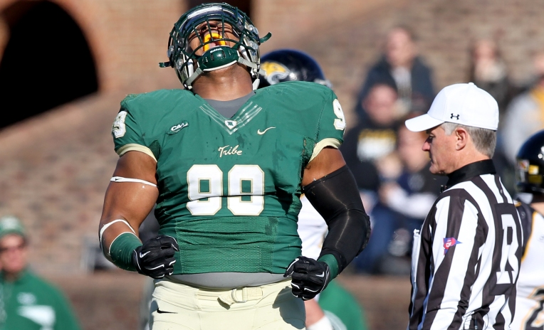 William & Mary's Tyler Clayton celebrates after bringing down Towson's Darius Victor for a loss during the first quarter Saturday November 14, 2015.
