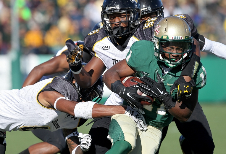 William& Mary's DeVonte Dedmon is dragged after a long reception by Towson's Diondre Wallace during the first quarter Saturday November 14, 2015.