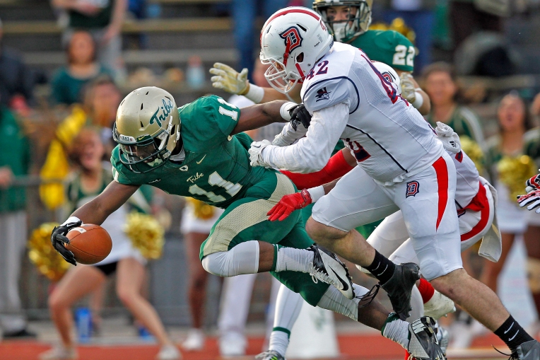 William and Mary's DeVonte Dedmon dives for the end zone for a touchdown past Duquesne's Carter Henderson during Saturday's game at Zable Stadium November 28, 2015.