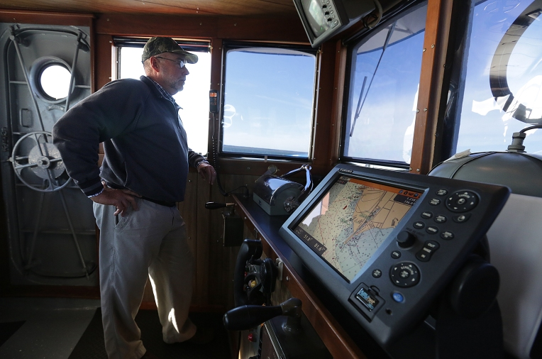 Captain Allen Sutton is relaxed, but ever aware of other boat traffic on the James River. On December 3, 2015, a Daily Press reporter and photographer took a ride with current tugboat operators at Newport News Shipbuilding to reflect on the 125th anniversary of the launching of tugboat Dorothy, which was Dec. 18th.