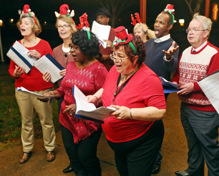 Hampton City Council members sing Christmas carols to a group at Burbank Elementary School in Hampton on Tuesday, Dec. 22, 2015.
