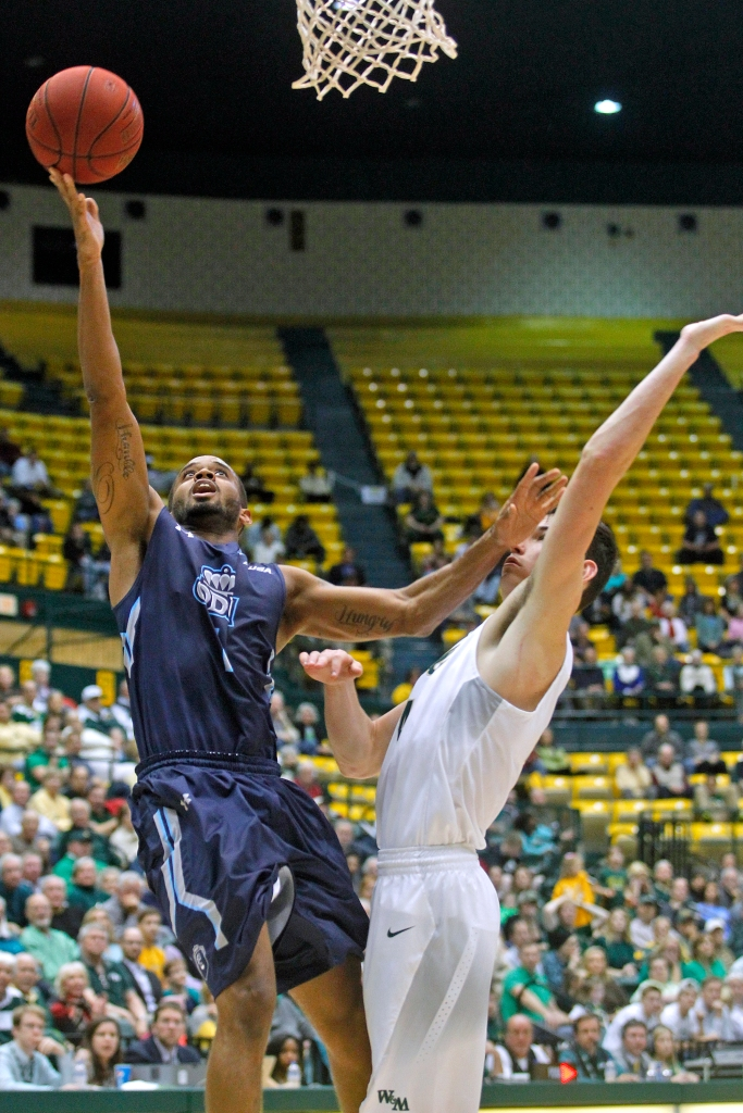 Old Dominion's Aaron Bacote, left, drives to the basket around William and Mary's Omar Prewitt during Tuesday's game at Kaplan Arena December 01, 2015.