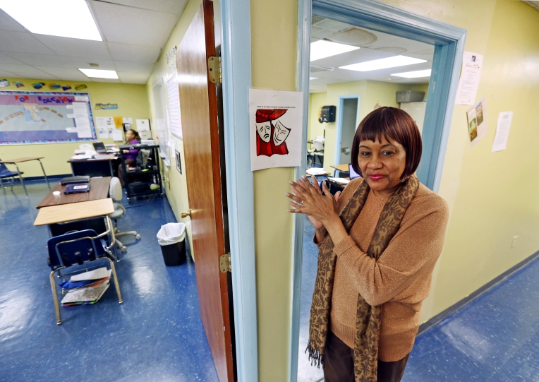 Teacher Norine Edwards stands in the hallways of East End Academy after school has been let out early on Thursday, Jan. 28, 2016. The private alternative school is being forced to relocate due to a developer planning to build a Family Dollar store.