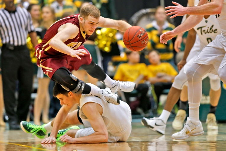 Elon's Luke Eddy loses his footing while colliding with William and Mary's Oliver Tot during Thursday's game at Kaplan Arena on January 21, 2016.