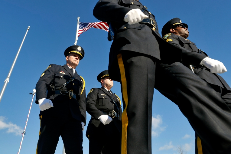 Members of Newport News Police Color Guard march after raising the American flag during Tuesday's grand opening ceremony of the Newport News Police Department's South Precinct building located at 3303 Jefferson Avenue on January 5, 2016.