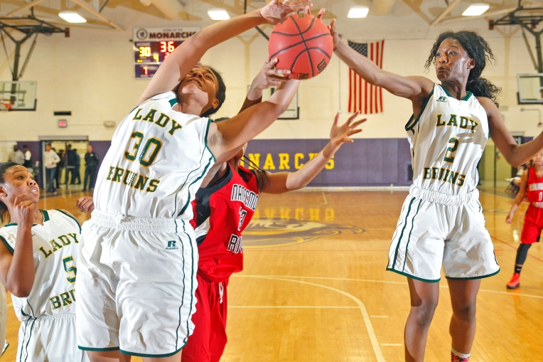 Bethel's Manaia Barnes, left, and Dayvondria Braxton, right, rebound the ball away from Nansemond River's Nijha Shannon during Saturday's PenSouth Conference10 final at Menchville High School on February 20, 2016.