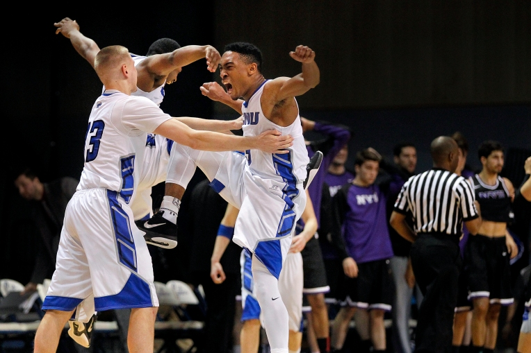 Christopher Newport University's Hunter Wetherell, left, Aaron McFarland and Marcus Carter, right, celebrate after defeating New York University 67-64 during Saturday's second round NCAA Division III game at the Freeman Center March 5, 2016.