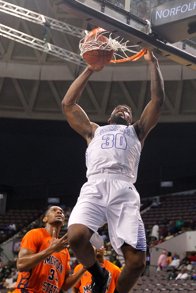 Hampton University's Jervon Pressley, right, slam dunks the ball over Morgan State's Cedric Blossom, left, during Wednesday's quarterfinals of the MEAC tournament at the Scope Arena in Norfolk.