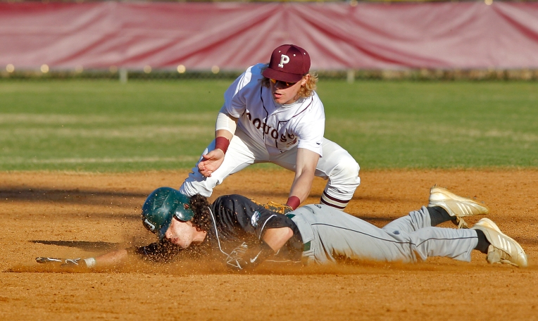 Poquoson's Dylan Freeman tags out Jamestown's Roger Romero during Friday's baseball game on March 18, 2016.