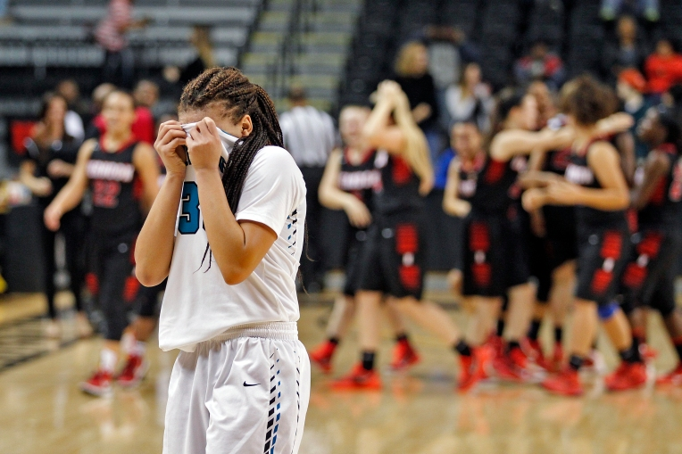 Woodside's Tyana Scott reacts after losing 53-41 to Herndon during Friday's 6A state quarterfinal at the Siegel Center on the campus of Virginia Commonwealth University.
