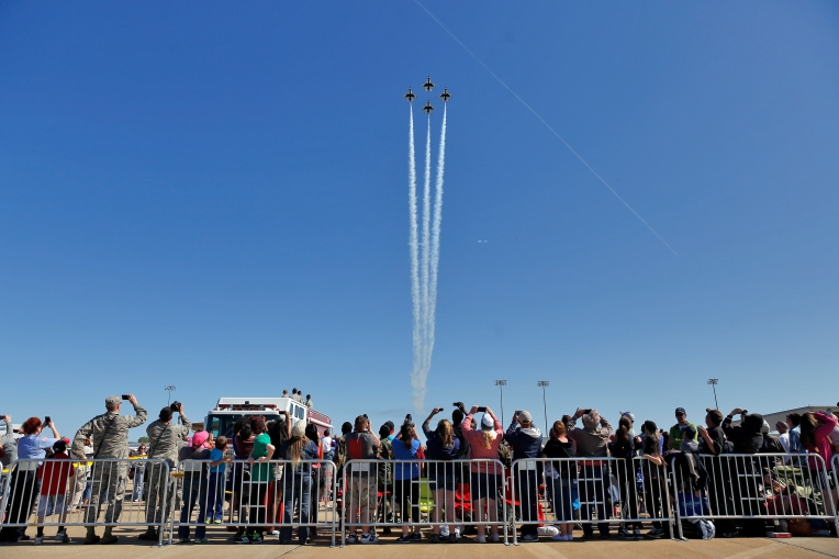Spectators watch the Thunderbirds perform during Sunday's Langley Air Power over Hampton Roads air show at Langley Air Force Base April 24, 2016.