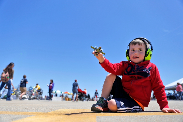 Jonathan Finley, 3, of Gloucester plays with a toy plane during Sunday's Langley Air Power over Hampton Roads air show at Langley Air Force Base April 24, 2016.