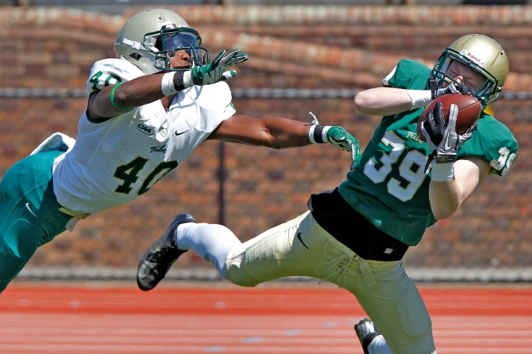 William and Mary's Grant Waxter, right, catches the ball around Simeon Brown during Saturday's spring football game at Zable Stadium on April 16, 2016.