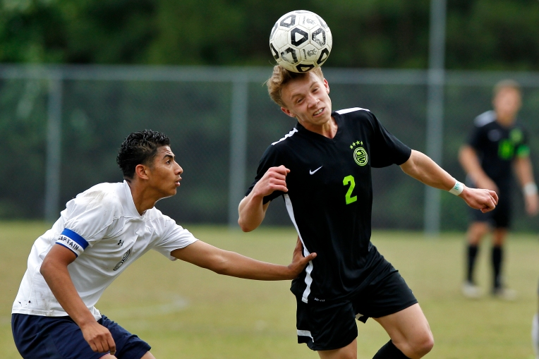 Jamestown's Drake Renner, right, heads the ball away from Denbigh's Irvin Sanchez during Friday's Conference 18 tournament on May 20, 2016.