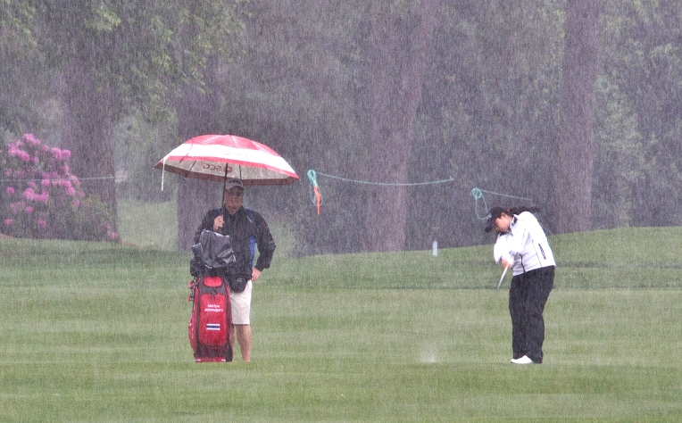 Moriya Jutanugarn hits an approach shot on the 9th fairway at Kingsmill's River Course during a steady downpour on Tuesday May 17, 2016.