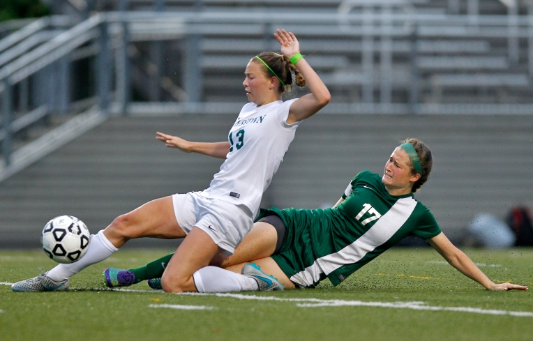 Great Bridge's Jess Stuart, right, slide tackles Jamestown's Sofie Fox during Monday's 4A East Region quarterfinal Monday evening at Wanner Stadium on May 30, 2016.