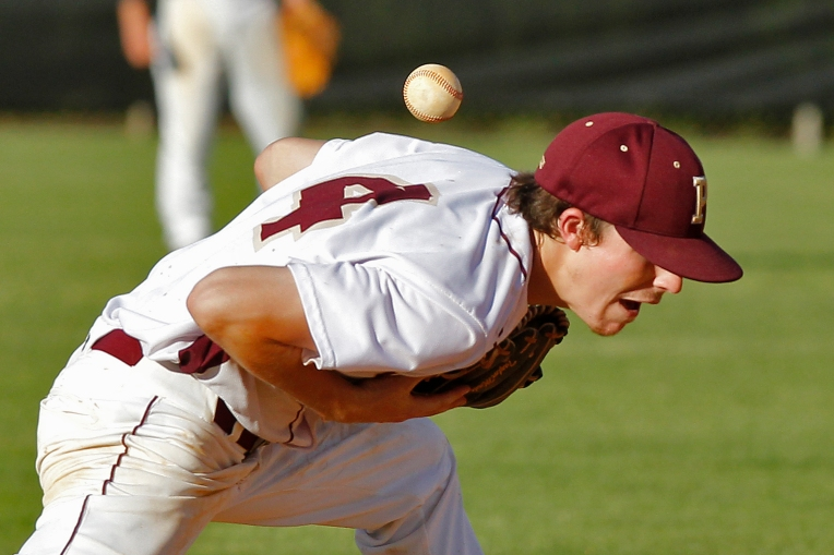 Poquoson's Sean Conners bobbles catching the ball during Tuesday's 3A East region quarterfinal against York on May 31, 2016.