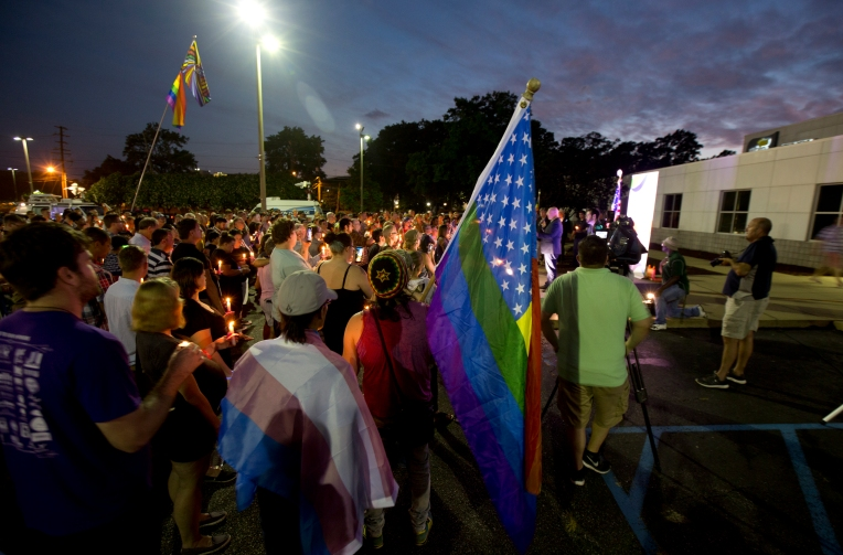People gather outside WHRO for a vigil for the victims of the mass shooting in Orlando, Fl. on Sunday June 12, 2016.