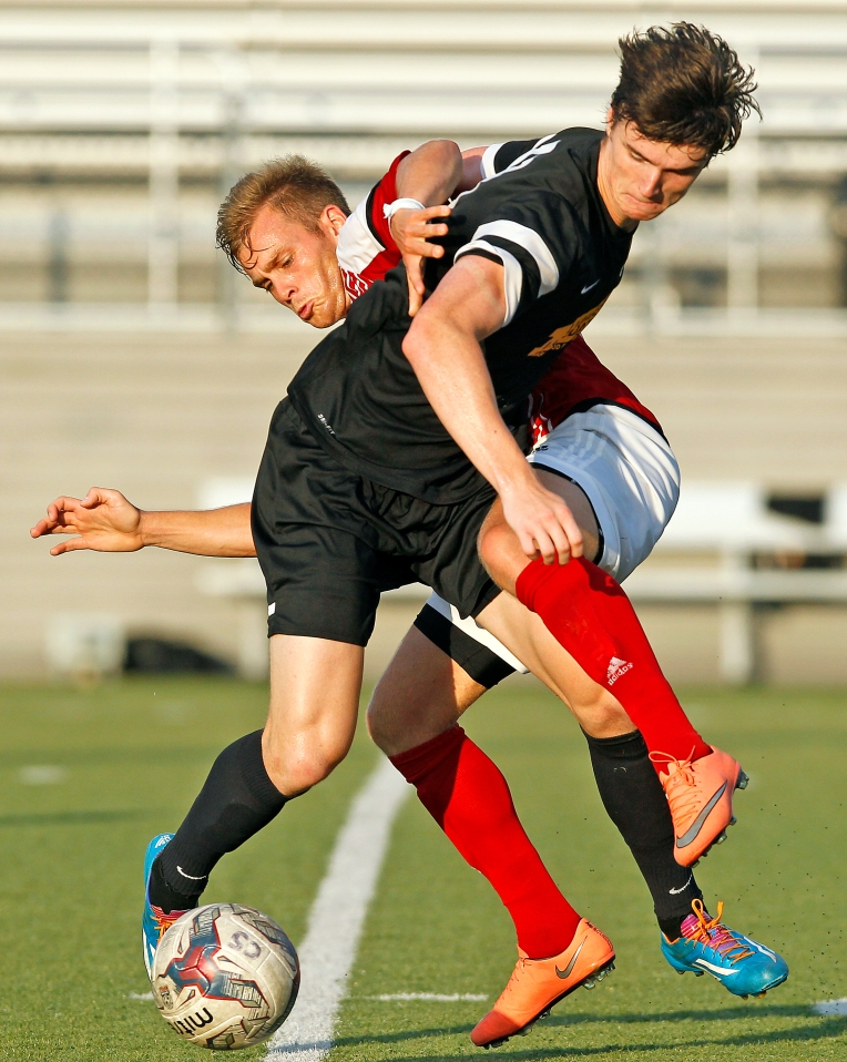 Virginia Legacy 76's James Grace, left, battles for control with Fredericksburg FC's Nick Rich during Tuesday's National Premier Soccer League game at Wanner Stadium June 28, 2016.