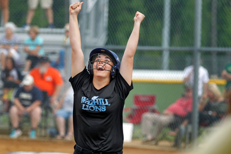 Warhill's Maddy Bradshaw celebrates after crossing home plate to give the Lions a 1-0 lead during Wednesday's 3A East Region semifinal against Skyline on June 1, 2016.