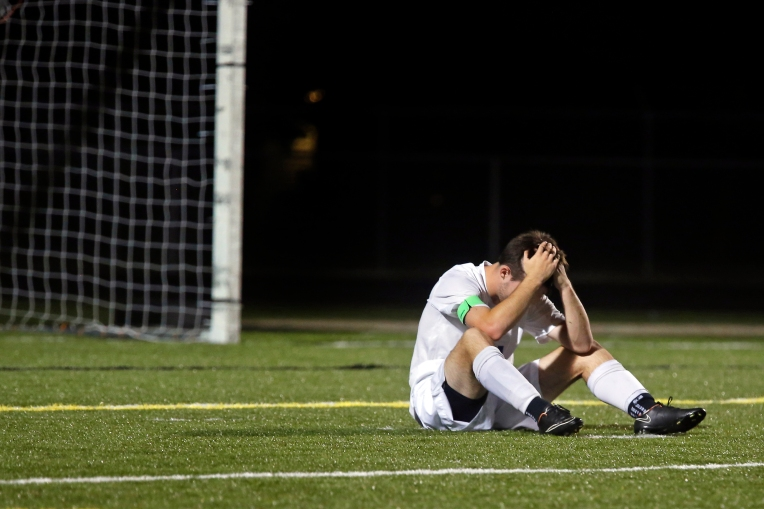 York's Cameron Dail holds his head after losing 1-0 to James Monroe during Thursday's 3A East Region semifinal on June 2, 2016.