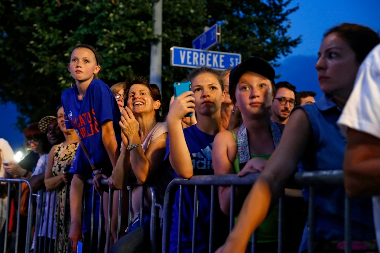 Audience members listen as former Secretary of State Hillary Clinton speaks during a rally in Harrisburg Friday evening July 29, 2016.
