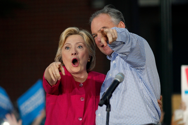 Senator Tim Kaine and former Secretary of State Hillary Clinton greet fans during a rally in Harrisburg Friday evening July 29, 2016.
