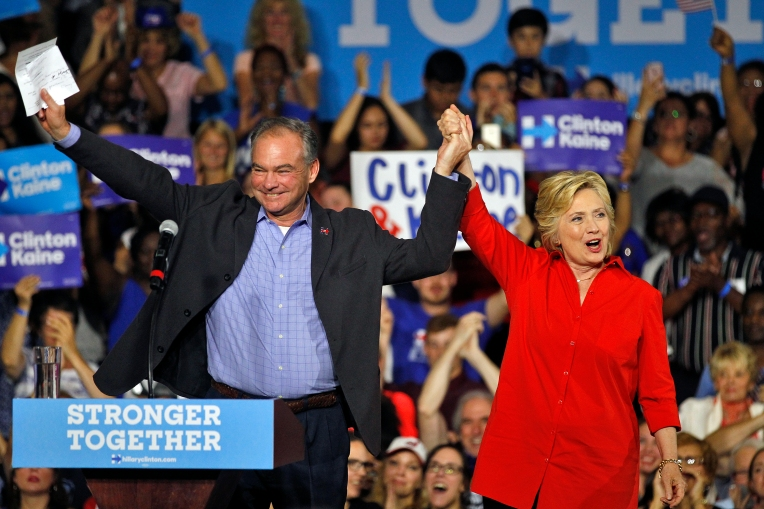 Hillary Clinton and Senator Tim Kaine receive cheers from the audience at East High School in Youngstown, Ohio Saturday evening July 30, 2016.