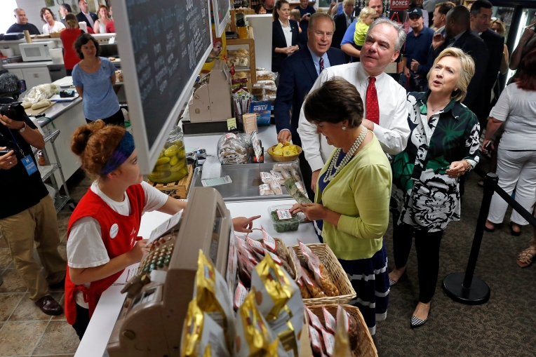 Senator Tim Kaine and Hillary Clinton look over the menu as Kaine's wife, Anne Holton, purchases items at Grandpa's Cheesebarn in Ashland, Ohio Saturday July 31, 2016.