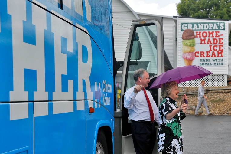 Senator Tim Kaine and Hillary Clinton leave their bus to enter Grandpa's Cheesebarn in Ashland, Ohio Saturday July 31, 2016.