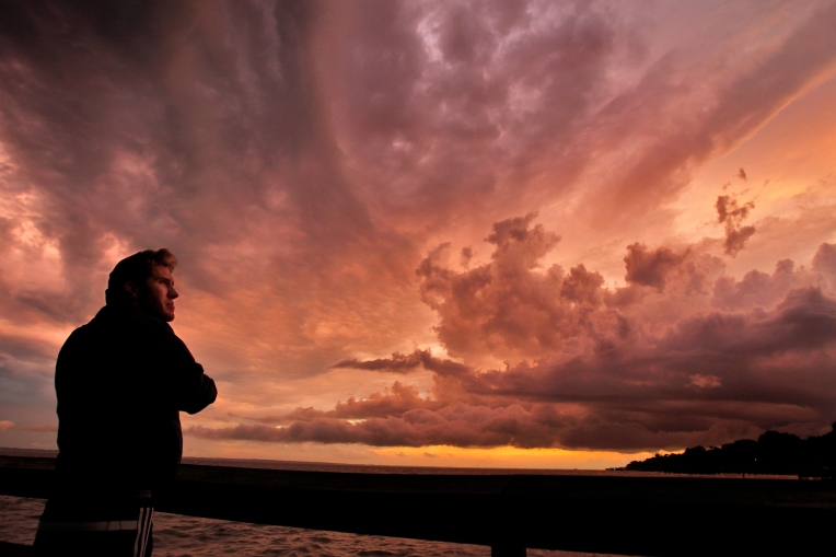 Connor Shapiro watches the clouds change color as a storm moves past the James River Tuesday evening July 19, 2016.
