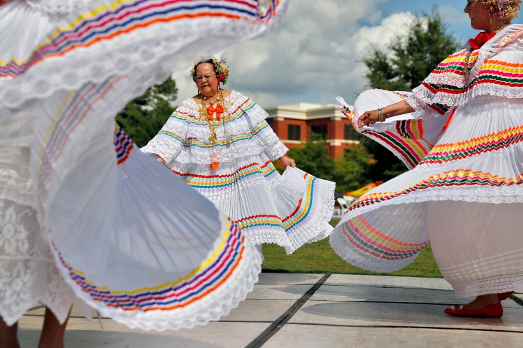 Gloria Day, center, and other members of the Panamanian Folkoric Group of Hampton Roads perform Saturday afternoon during the World Arts Celebration at City in Newport News on July 16, 2016. The event featured performances, food, exhibits and activities from various cultures from around the world.