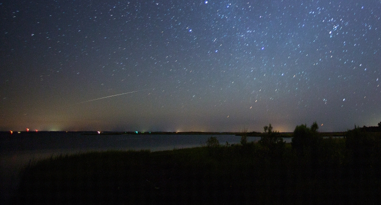 A single Perseid meteor flies over the Severn River in Gloucester Friday morning August 12, 2016 around 3 A.M.