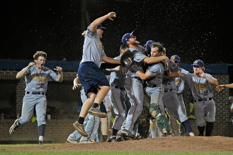 Savannah Bananas players celebrate after defeating the Peninsula Pilots during Tuesday's game three of the Coastal Plain League Petitt Cup Championship at War Memorial Stadium on August 16, 2016.