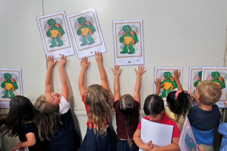 Warwick River Christian School students marvel at their signed lithographs from children's illustrator Kurt Lehner Thursday morning September 8, 2016. Lehner taught the students about illustration and demonstrated how to draw Franklin the Turtle.