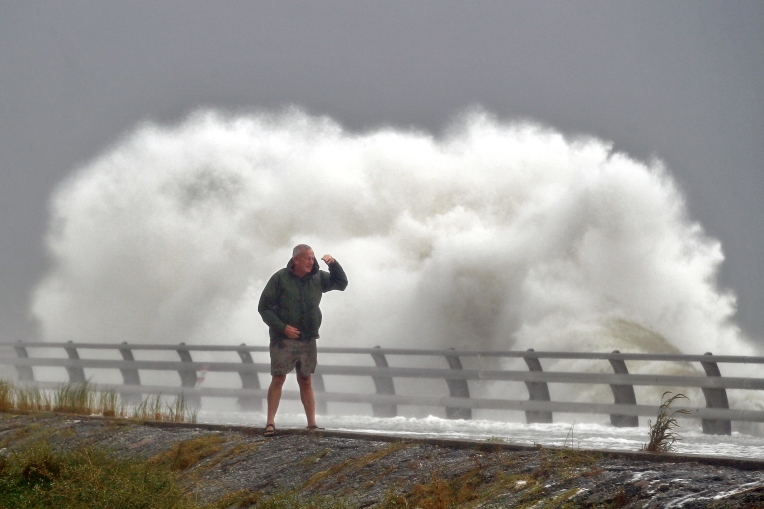 Bob Killebrew watches as waves crash ashore on Fort Monroe Saturday September 3, 2016.