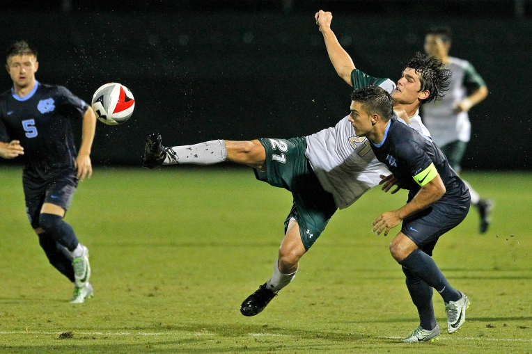 William and Mary's Reeves Trott kicks the ball around University of North Carolina's Colton Storm, right, during Tuesday's game at Martin Family Stadium September 20, 2016.