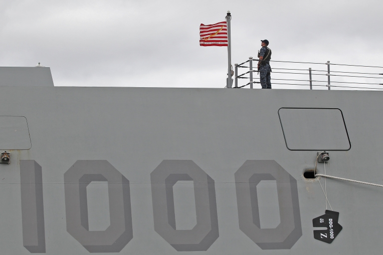 Petty Officer First Class Mike Gaines stands on the deck of the guided-missile destroyer Pre-Commissioning Unit (PCU) Zumwalt (DDG 1000) at Naval Station Norfolk Friday afternoon September 16, 2016.