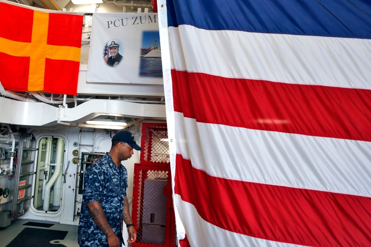 Sailors walk through the guided-missile destroyer Pre-Commissioning Unit (PCU) Zumwalt (DDG 1000) during a tour at Naval Station Norfolk Friday afternoon September 16, 2016.