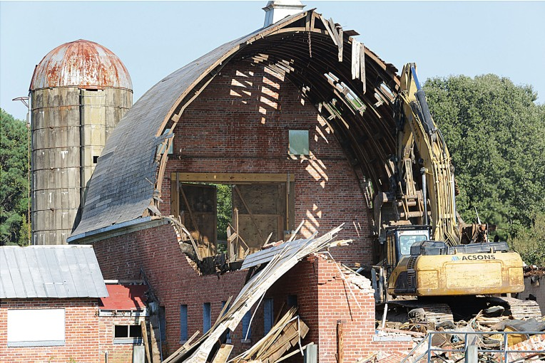 Demolition work on the barn at the former City Farm in Newport News happened today, October 19, 2016.