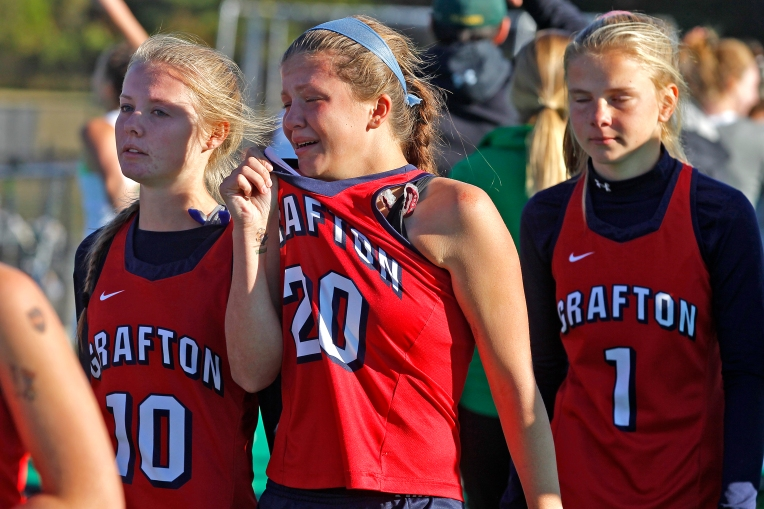 Grafton's Corinne Tapajna, left, Grace Hoepfner, center, and Abby Zwirschitz, right, react after losing to Great Bridge in a shootout during Saturday's Group 4A state championship game at the USA National Field Hockey Training Center in Virginia Beach November 12, 2016.