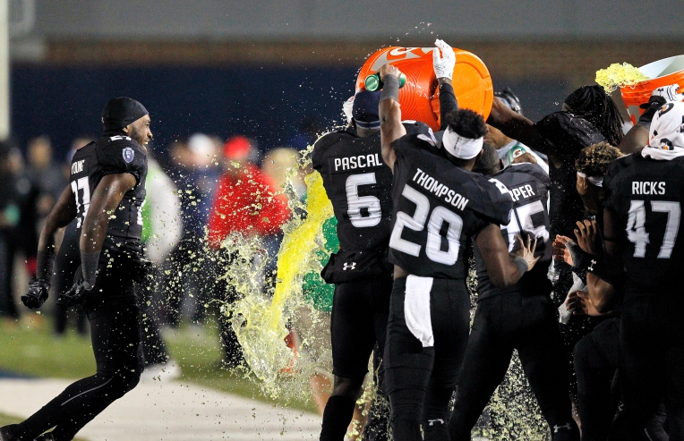 Old Dominion University head coach Bobby Wilder is doused with Gatorade by his players in the closing minutes during Saturday's game against Marshall at Ballard Stadium November 5, 2016.